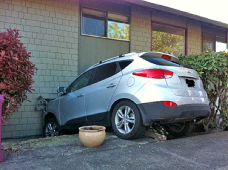 by: COURTESY OF TUALATIN VALLEY FIRE & RESCUE - COULD HAVE BEEN WORSE  - A driver accidentally hit the accelerator instead of the brake and drove his car into a King City Apartments building on April 26, but no one in the car of the apartment was injured.