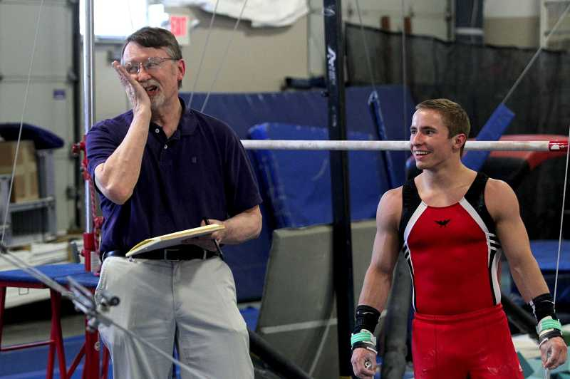 by: TIMES PHOTO: JONATHAN HOUSE - Longtime gymnastics judge Doug Hills makes a joke while giving advice during a training session for local qualifying athletes at the Oregon Gymnastics Academy in Beaverton.