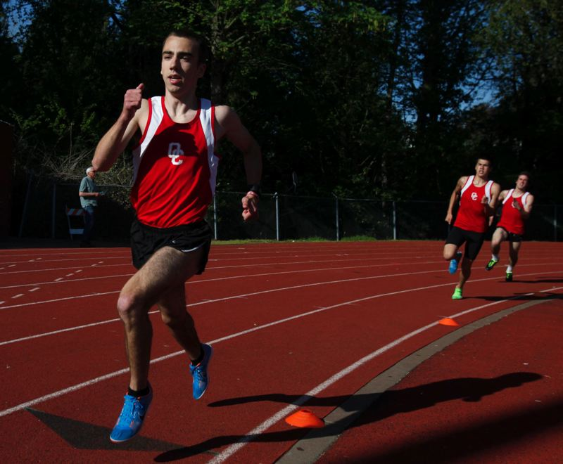 by: JONATHAN HOUSE - Oregon City distance runners (from left) Al Lacey, Chris Durant and Keaton Stroh swept the 1,500 meters to help lead the Pioneers to a 100-45 runaway win over Clackamas in last weeks Three Rivers League meet in Oregon City.