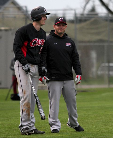 by: JONATHAN HOUSE - Austin Kelly (left) and his teammates have given Clackamas coach John Arntson (right) and his coaching staff a lot to smile about this season.