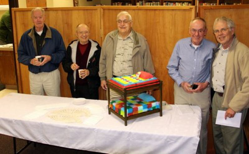 by: SUBMITTED PHOTO - Left to right, bunk bed builders, Jerry Cook, Bert Cranston, Ed Minster, Joe Sawtell and Arnie Anderson get ready to enjoy a piece of bunk bed cake.
