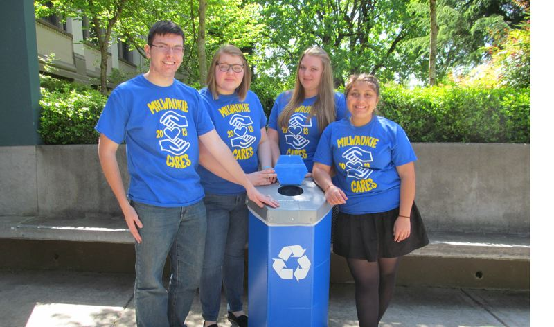 by: PHOTO BY ELLEN SPITALERI - Milwaukie Cares members Brandon Kneebone, Courtney Ryman, Emme Eubanks and Leticia Frutis get ready to pick up trash on May 2, the day before Milwaukie's First Friday.