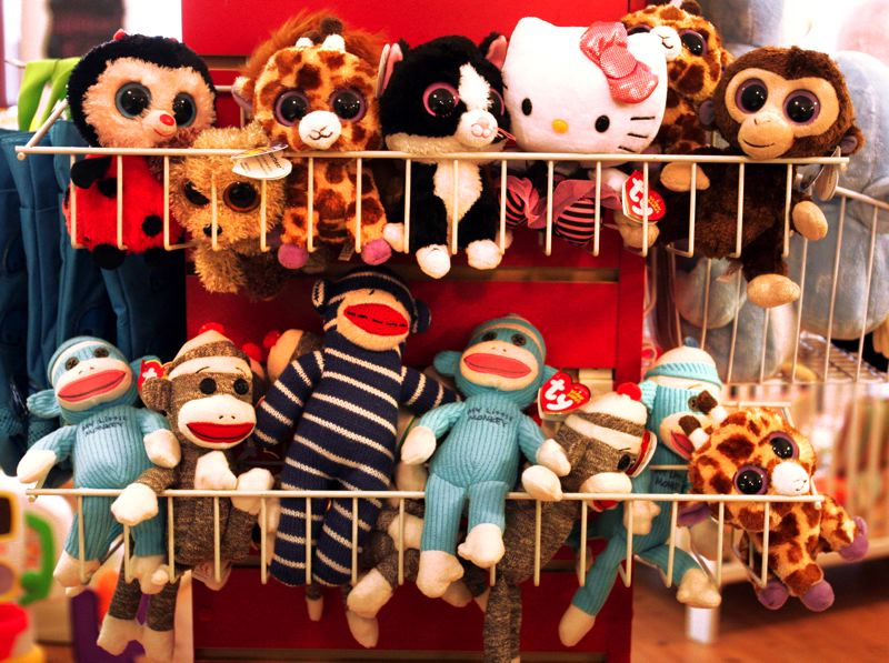 by: OUTLOOK PHOTO: JIM CLARK - A collection of small stuffed toys at All About Kids.