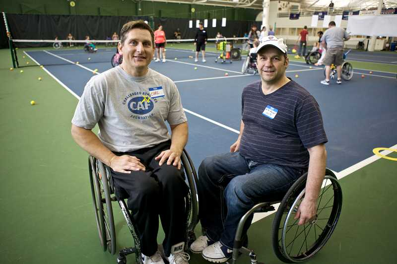 by: TIMES PHOTO: JAIME VALDEZ - Carl Backstrom and Mike Meyer co-founded the Northwest Wheelchair Tennis Association's Wheelchair Tennis Camps for Kids.