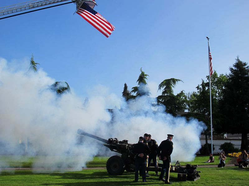 by: NEWS-TIMES PHOTO: KATHY FULLER - Members of the Oregon National Guard 218th Field Artillery unit based in Forest Grove fire a blank from an Army howitzer Friday during the rededication of Veteran Memorial Park in Cornelius.