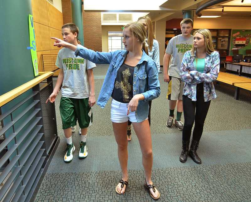 by: VERN UYETAKE - West Linn High School junior Ashley Johnson, center, led a tour of the school for incoming ninth-graders Erik Edmond, left, Miranda Rose and Jake Luther.