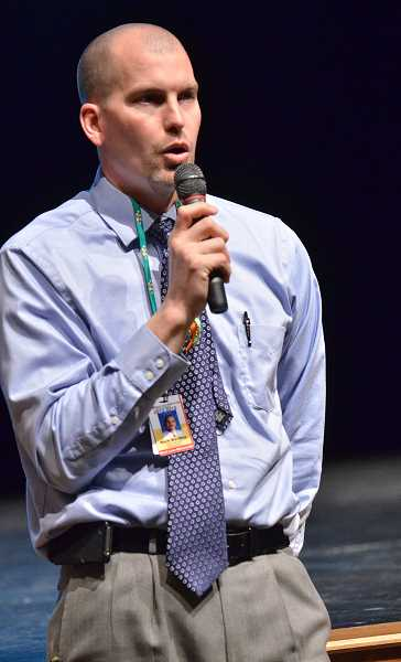 by: VERN UYETAKE - Assistant Principal Mark Martens explains to the incoming students what to expect next year at West Linn High School.