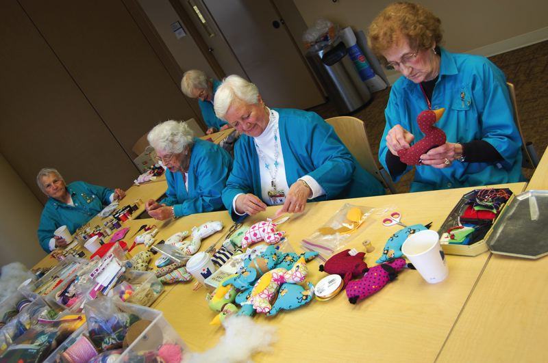 by: KAITLYN MORRELL - Volunteer Sewing Ladies include (from left) Marci Clark, Agnes Stiles (in background), Gert Pearson, Ann Borski and Mayme Kidd.