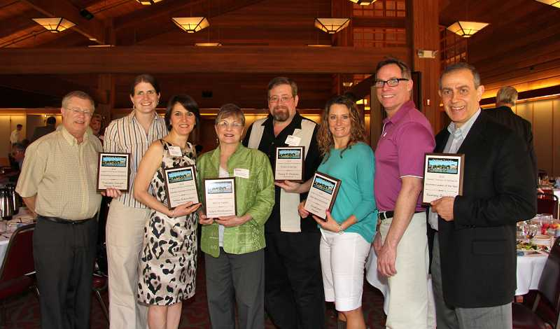 by: SUBMITTED PHOTO - The Tualatin Chamber of Commerce recognized Mike Shiffer, Tracy Smith, Valia Eskandari, Loyce Martinazzi, Perry P. Perkins, Amy Freeman and Jeff Houghtaling of ClubSport Oregon and Ramsey Zawideh.