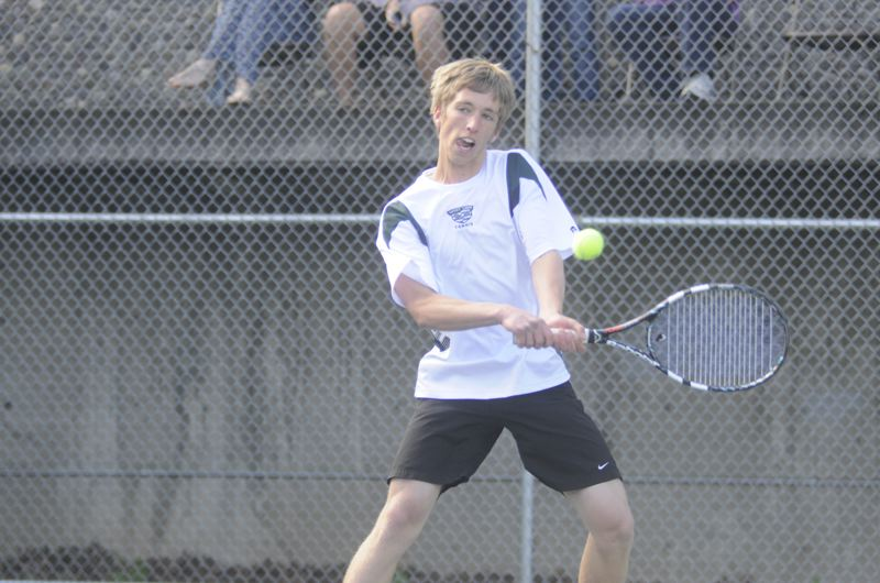 by: MATTHEW SHERMAN - Craig Wright returns a shot at this week's district tennis tournament. He and partner Mitch Tingey finished third in the tournament and earned a trip to state.