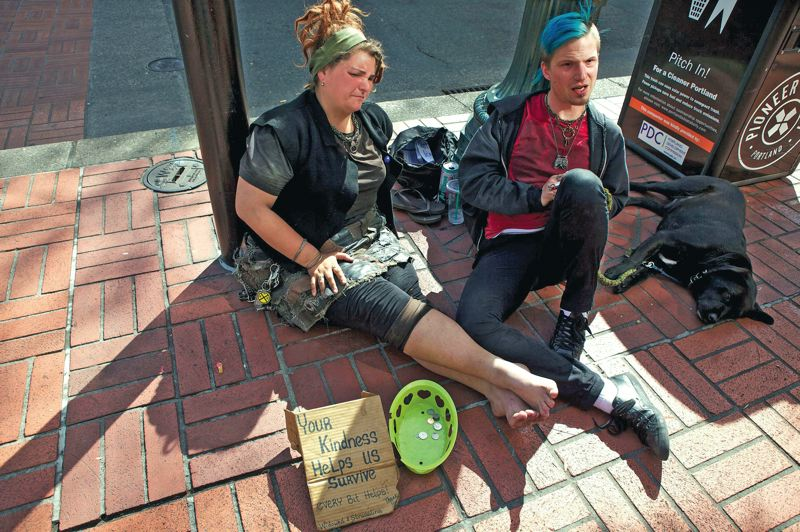by: TRIBUNE PHOTO: JAIME VALDEZ - Jen, here with friend Levi, says most of the street crimes attributed to travelers are committed by a younger generation she calls 'oogles.'