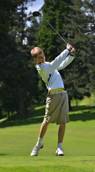 by: VERN UYETAKE - West Linn's Ryan Kelley fired a 79 at Oswego Lake Country Club, trying for his team's lowest round.