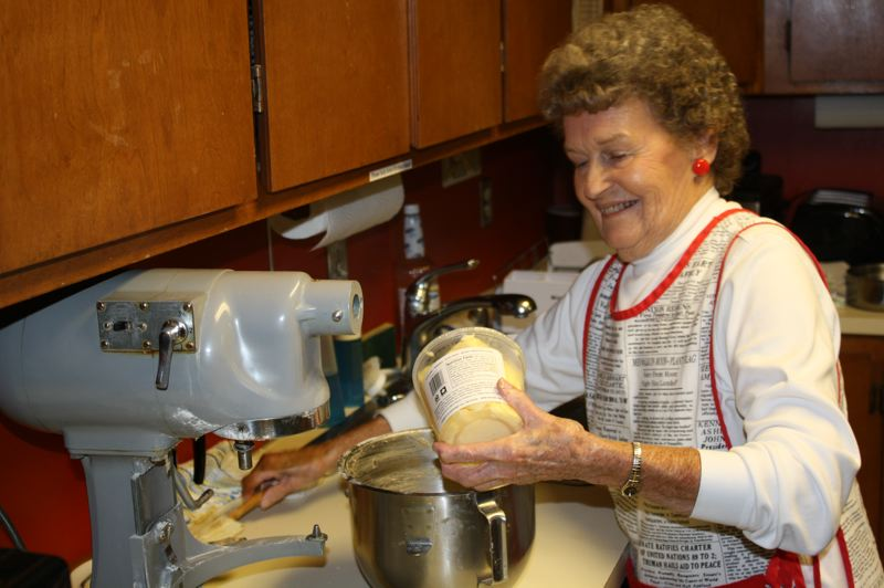 by: POST PHOTO: JIM HART - VFW Auxiliary member Lois Leavitt adds butter as she operates a commercial mixer while preparing the dough for peanut butter cookies.