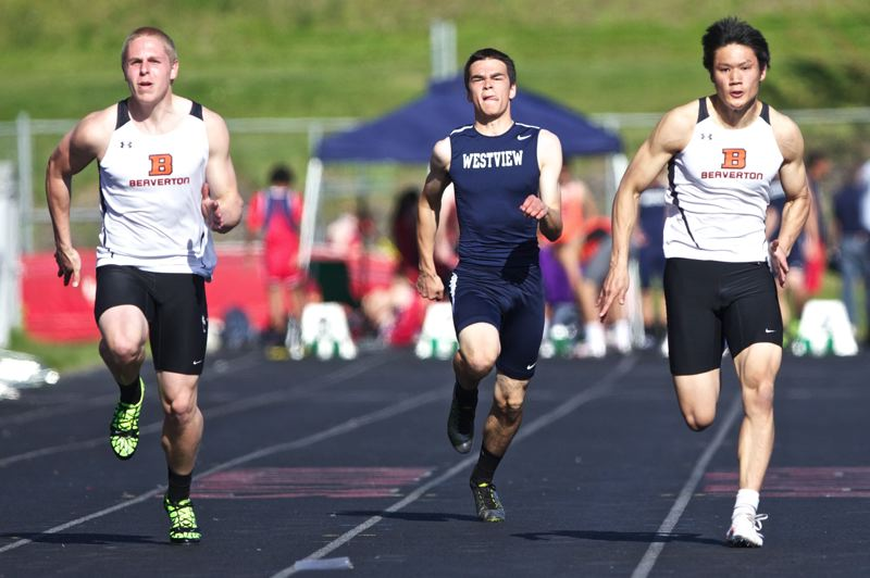 by: JAIME VALDEZ - Beaverton's Ross Hoffman and Matthew Kim sprint to the finish line in the 100-meter run in a dual meet against Westview at Westview High School. Hoffman won the race with a time of 11.38.