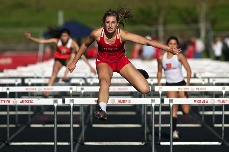by: JAIME VALDEZ - Westview High's Hannah Lautenbach jumps over the last hurdle in the 100 meter  hurdles to win the event with a time of 16.32 in a dual meet with Westview at Westview High School.