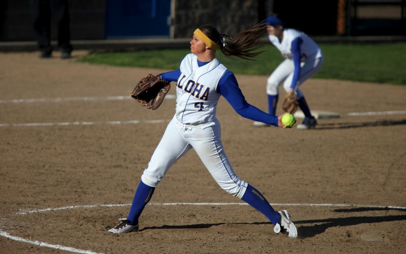 by: JIM NEWTON - PERFECT PITCHER -- Aloha senior Kiana Wood gets ready to fire a pitch to the plate during her perfect-game performance against Southridge.