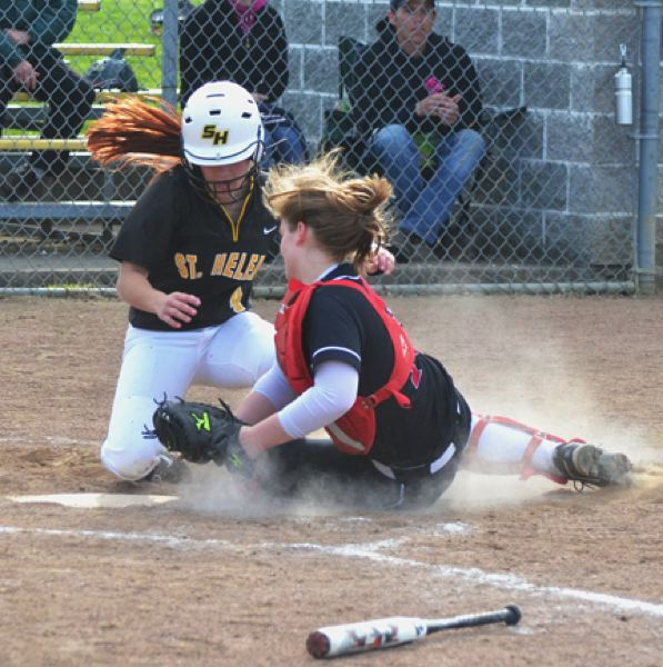 by: JOHN BREWINGTON - St. Helens' Ashley Giesbers is safe at home for the Lady Lions only run against Sandy in a 2-1 loss on Tuesday. The win gave Sandy an insurmountable lead for the NWOC title. Sandy's catcher is Rachel Rutledge.
