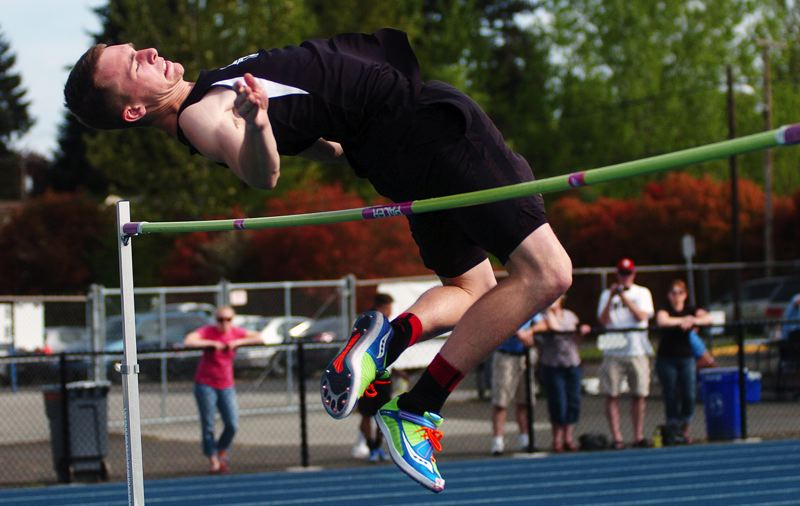 by: DAN BROOD - GOING HIGH -- Sherwood senior Zach Milligan looks to clear the bar during Saturday's Aloha Relays.