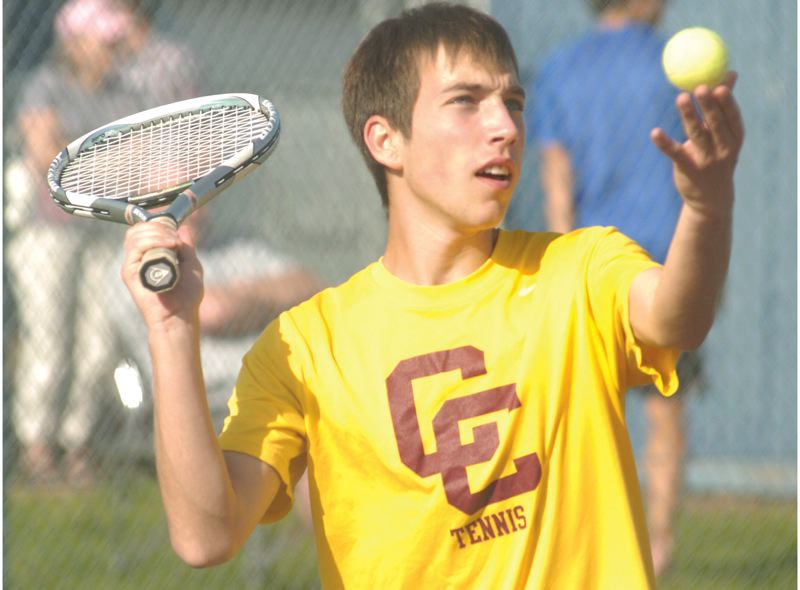 by: PAMPLIN MEDIA GROUP: DAVID BALL - Central Catholics Michael Kuhn makes a serve during a 6-4, 6-2 loss in the No. 3 doubles match.