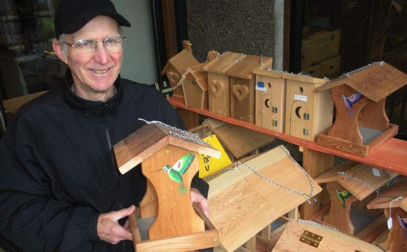 by: POST PHOTO: JIM HART - Jack Foote shows some of the bird houses and bird and squirrel feeders he will have on display Saturday, May 4, at the AEC Building in Sandy.
