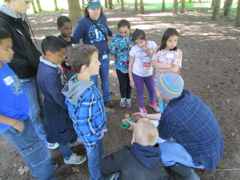 by: SPOTLIGHT PHOTO: ROBIN JOHNSON - 3rd Graders from James John Elementary in St. Johns learn about producers, consumers, and decomposition in the woods of Sauvie Island Farms.