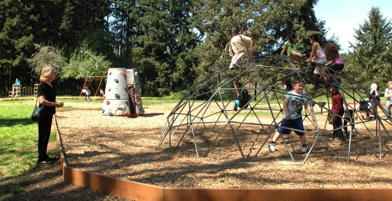 by: ESTACADA NEWS PHOTO: ISABEL GAUTSCHI - Juli Hager watches her grandson Alex play on the jungle gym.