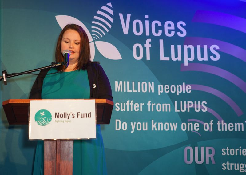 by: ILDIKO ARNDT; WHITE LION PHOTOGRAPHY & DESIGN - Molly McCabe, co-founder of Molly's Fund, talks about her experience with lupus at a press conference on Friday.