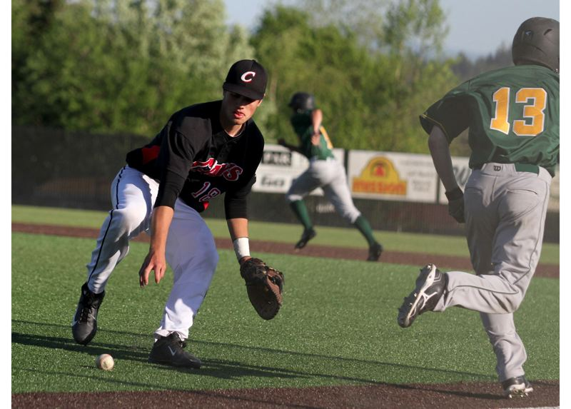 by: JONATHAN HOUSE - Clackamas first baseman Jarrod Switzer fields a bunt in last Fridays barnburner with West Linn. The Cavaliers scored their winning run with two out in the bottom of the seventh and salvaged a 4-3 victory, their 20th win in 22 games this spring.