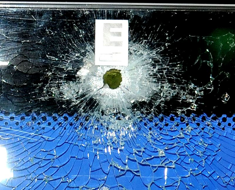 by: PHOTO COURTESY: CCSO - A bullet hole in a window at Clackamas Town Center was one of several that Clackamas County law enforcement found after the Dec. 11 shooting. The local community responded by memorializing the victims, Steve Forsyth and Cindy Yuille.