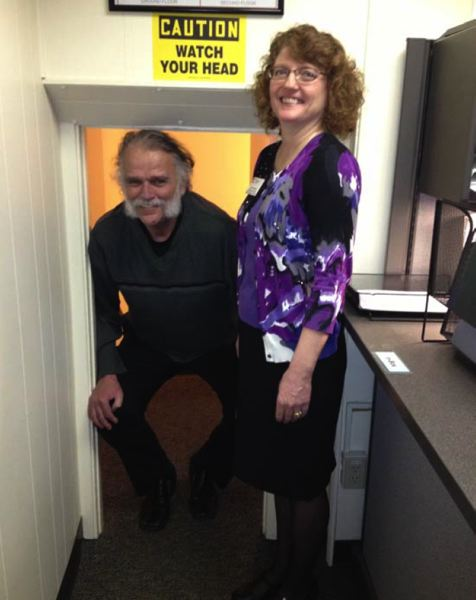by: PHOTO COURTESY: OREGON CITY - Pictured with Julie Paulsen of the Oregon City Chamber of Commerce, Mayor Doug Neeley has trouble getting through a doorway in the Oregon City Public Works building, where leaders are hoping to invest in new infrastructure in the coming years.