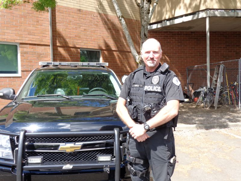 by: PHOTO COURTESY: MPD - Milwaukie Police Officer Les Hall poses with a type of SUV that he will use to transport the department's newest canine officer.