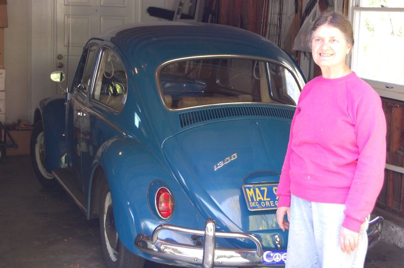 by: PHOTO BY: RAYMOND RENDLEMAN - Sherien Jaeger uses her 1966 Volkswagen Beetle as an everyday car since buying it new.