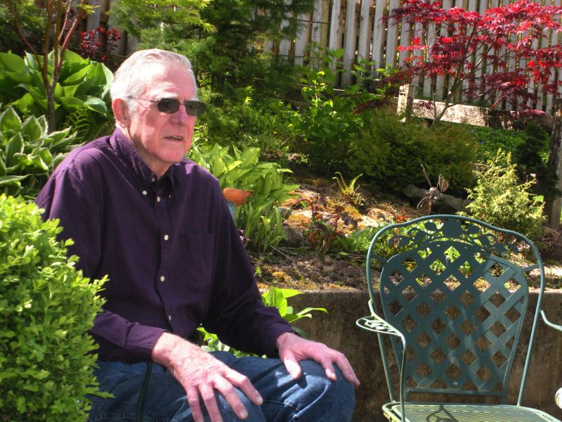by: POST PHOTO: JIM HART - Dick McQueen relaxes on the outdoor patio of his home in Gresham. After setting an example for people who would choose an altruistic lifestyle, McQueen was honored recently with the first recognition in a series planned as annual volunteer awards, bearing McQueens name. The award is sponsored by the Oregon Democrats of House District 52, which includes parts of three counties.