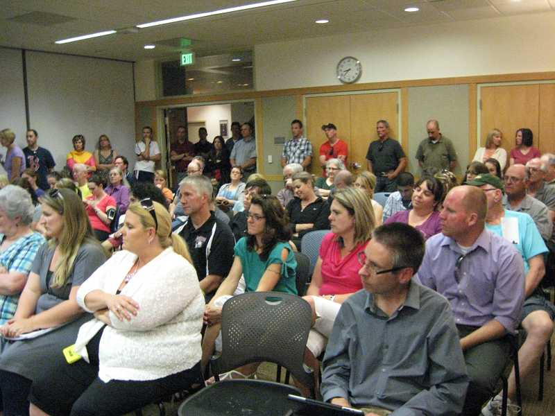 by: RAY PITZ - Sherwood residents packed the Sherwood City Council chambers Tuesday night to express opposition to the proposed Walmart store.