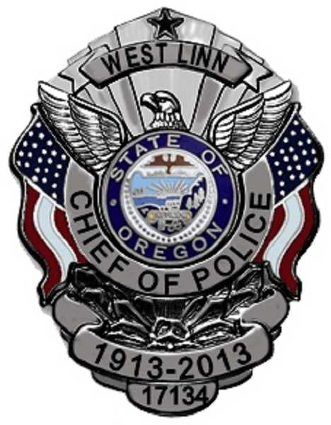 by: SUBMITTED PHOTO: WEST LINN POLICE DEPARTMENT - The new centennial police badge features the American flag and an eagle.