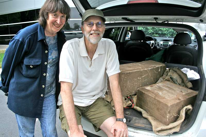by: REVIEW, TIDINGS PHOTO: J. BRIAN MONIHAN - Bruce McAlister and Karen Offen were all smiles after they loaded up the tombstone and prepared to take it back to Eugene last August.