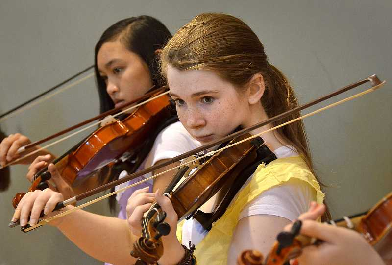 by: VERN UYETAKE - Rosemont seventh-graders Lily Burnett and Tya Smith play Ode to Joy during a musical presentation at the Renaissance Faire.