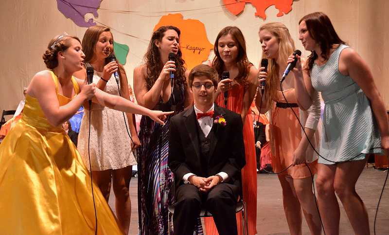 by: VERN UYETAKE - The girls' sextet serenades May Day King Connor Cushman is serenaded to the tune 'I Knew You Were Trouble.'