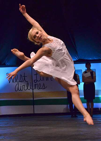 by: VERN UYETAKE - Maddie Groh flies through the air during her lyrical dance performance as part of the student talent.
