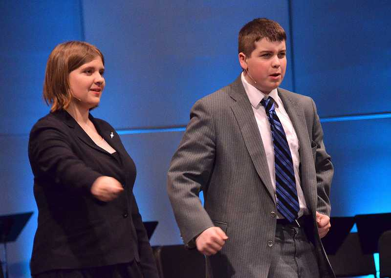 by: VERN UYETAKE - Speech and debate performers Elise Brown and Joe Erickson interpret 'The Butter Battle Book' by Dr. Suess.