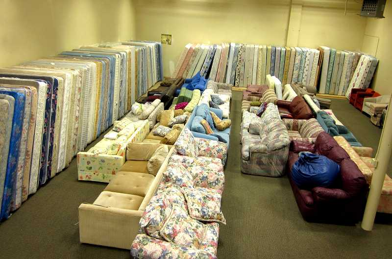 by: SUBMITTED PHOTO - Hundreds of mattresses donated by Sealy will benefit the Tualatin Community Warehouse, shown here.