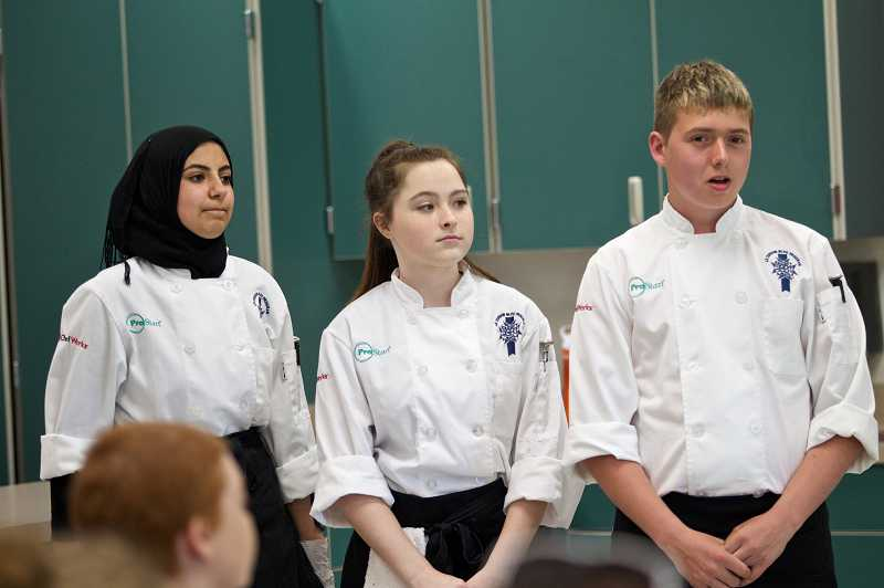 by: TIMES PHOTO: JAIME VALDEZ - Junior Farah Abu-Khater, sophomore Madeline Casey and sophomore Gabe Jensen participated in a cooking competition hosted by celebrity chef Maneet Chauhan at Tualatin High School.