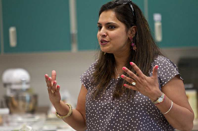 by: TIMES PHOTO: JAIME VALDEZ - Celebrity Chef Maneet Chauhan talks about her experiences being a chef during a cooking competition at Tualatin High School.