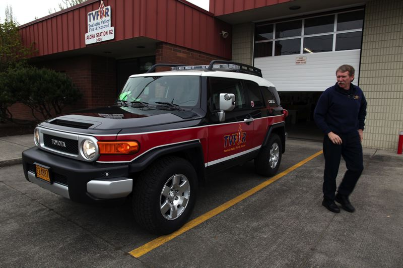 by: TRIBUNE PHOTO BY JAIME VALDEZ - Tualatin Valley Fire & Rescue began using smaller emergency response vehicles in 2010. Paramedic Steve Heisel checked out one of the specially-equipped Toyota FJ Cruisers when they were first unveiled.
