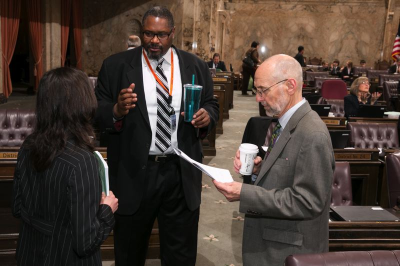 by: WASHINGTON STATE LEGISLATURE SUPPORT SERVICES - Eric Pettigrew, former Oregon State offensive lineman, discusses issues at the Washington State House.