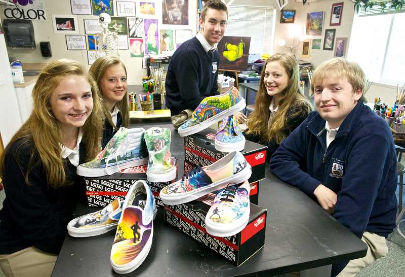 by: TIMES PHOTO: JAIME VALDEZ - Seven students at St. Stephen's Academy participated in a Vans-sponsored shoe design contest with the hopes of winning $50,000 for art programs at their school. Pictured are; sophomore Maddy Mier, sophomore Hannah Breckenridge, freshman Hayden Hupfer, sophomore Jessica Hayward and junior Austin Mier.