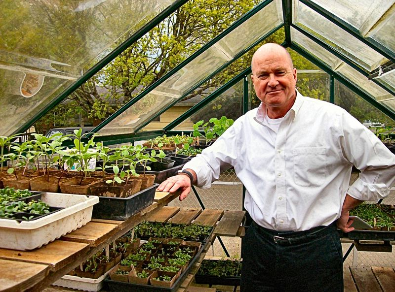 by: RITA A. LEONARD - Lewis School Principal Tim Lauer shows new seedlings growing in the greenhouse of the schools Learning Garden.