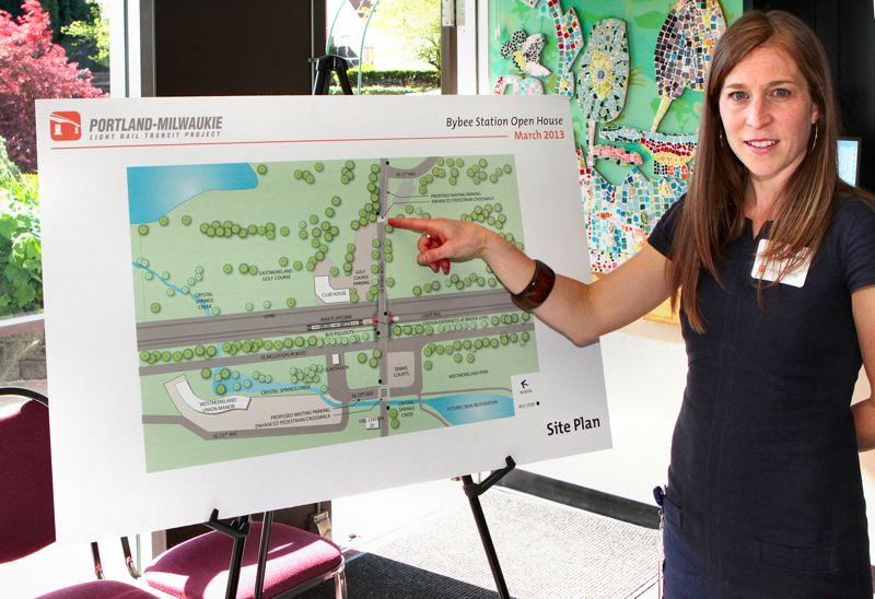 by: DAVID F. ASHTON - TriMet Portland-Milwaukie Light Rail Project Community Affairs representative Jennifer Koozer shows added crosswalks to come, on S.E. Bybee Boulevard. These will help pedestrians have more visibility for crossing, and will help to slow traffic, creating a bit of a gateway for the bridge station environment.