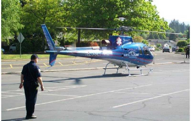 by: J. PATRICK MOORE - CLOSEST OPEN SPACE -- A LifeFlight helicopter waits to lift off with an accident vicitm from the King City Golf Course parking lot on May 8.