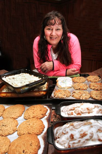 by: OUTLOOK PHOTO: JIM CLARK - Kelly Shewbert, shown here with some of her baked goods, will be selling cookies at the Gresham Farmers Market again this year.